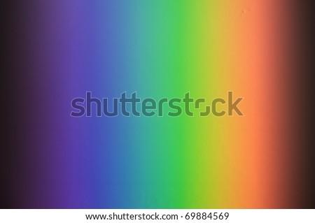 real sunbeam rainbow spectrum on bathroom tile wall - stock photo