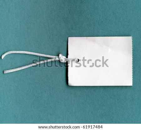 Real Tag With String On Color Paper - stock photo