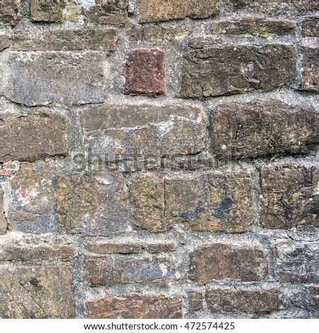 Real texture of old gray stone bricks. Quality photo background of brickwork. Good for 3D works or wallpaper, backdrop