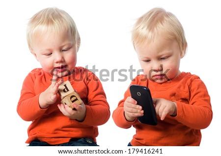 Real toys vs smart phone - stock photo