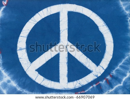 Real tye dye Peace Symbol on cotton knit material. - stock photo