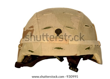 Real U.S. Army helmet and chin strap. This one served in Iraq. Focus = rank emblem = Specialist. - stock photo