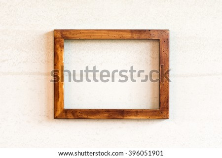 Real vintage old photo wooden frame on the wall. - stock photo