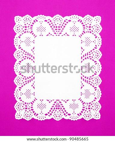 Real White Doily isolated on Fuchsia / Purple background - stock photo