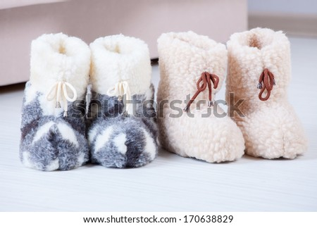 Real wool slippers, fluffy rustic style - stock photo