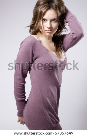 real young beautiful girl posing over a grey background - stock photo