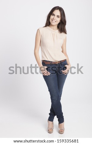 real young cute woman posing over a white background - stock photo