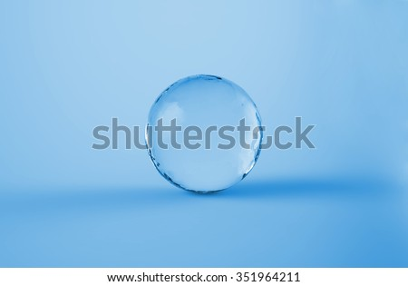 Realistic 3d sphere water glossy drop bulb ball cold clear concept on light blue background.  - stock photo