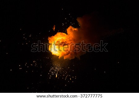 Realistic fiery explosion busting over a black background - stock photo