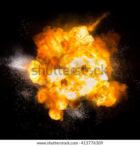 Realistic fiery explosion over a black backgroun - stock photo