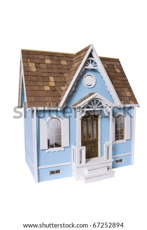 Realistic looking wooden dollhouse isolated on white with clipping path