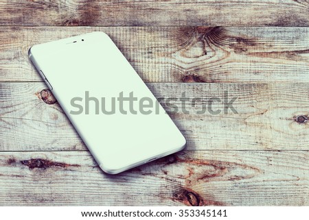 Realistic mobile phone iphon style mockup with blank screen and shadows on wooden background. Highly detailed illustration. - stock photo