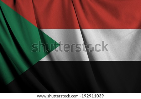 Realistic wavy flag of Sudan.  - stock photo