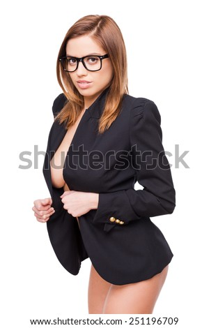 Really bad teacher. Attractive young woman with beautiful curves adjusting her jacket and looking at camera while standing against white background