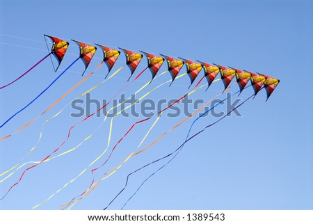 really long kite, color full tails