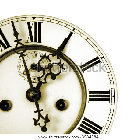 Really old clock face shot in Sepia with nice crafted pointers - stock photo