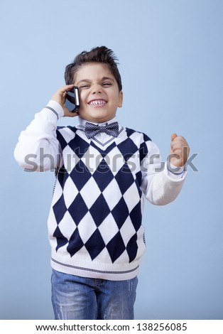 Really young businessman is celebrating his victory over the phone. - stock photo