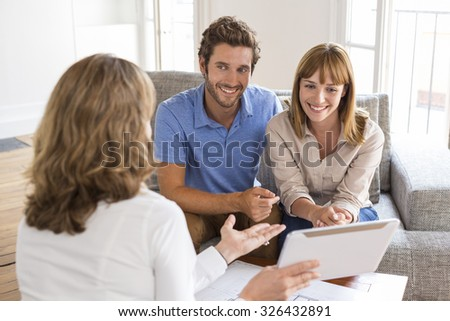 Realtor agent presenting a new project property on tablet pc - stock photo