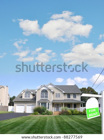 Realtor For Rent Sign on Lush Green Landscaped Front Yard Lawn of Large Beautiful Suburban Home in Residential District - stock photo