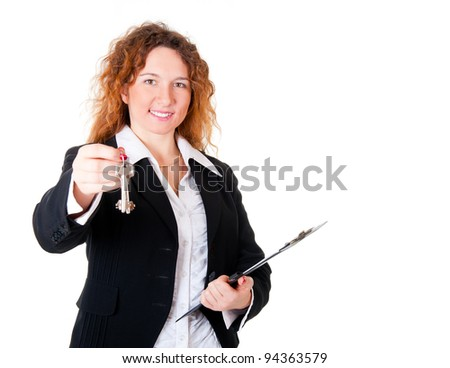 Realtor handing the keys isolated over white. Focus to face. - stock photo