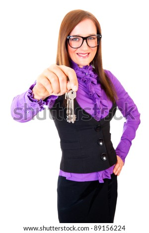 Realtor handing the keys isolated over white. Focus to key. - stock photo
