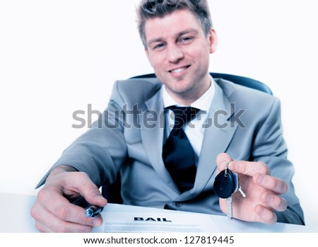 realtor holds key and lease agreement document  in hands - stock photo