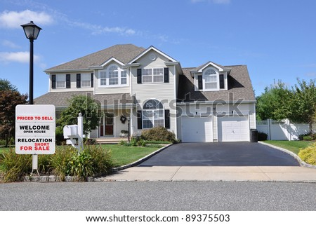 Realtor Relocation For Short Sale Sign on Curb of Beautiful Suburban Home on Sunny Blue Sky Day - stock photo