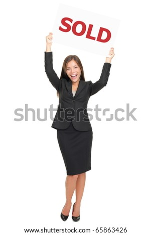 Realtor showing sold sign happy and excited. Smiling joyful Asian / Caucasian real estate agent woman celebrating a house sale. Isolated on white background standing in full length - stock photo