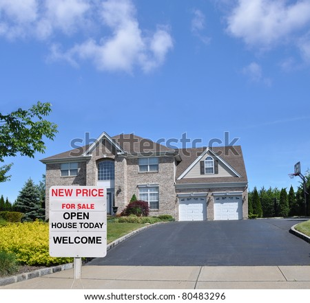 Realtors Open House Realty Sign at Driveway end of Suburban Luxury McMansion Home - stock photo