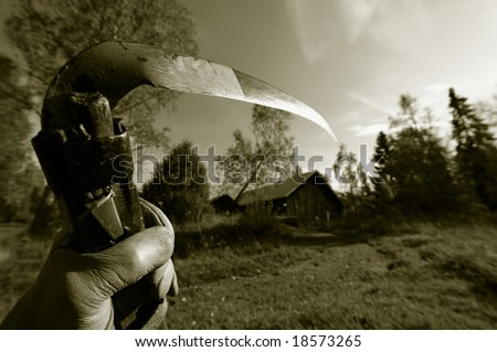 reaper concept, hand holding old scythe in late evening, on the way to old farm-house, dark sepia toning - stock photo