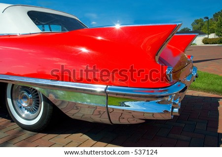 Rear fins of a classic car. - stock photo