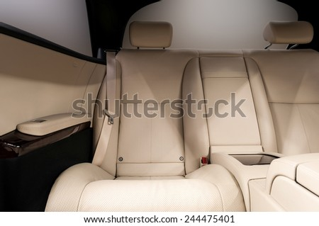 Rear leather seats. Business car interior. - stock photo