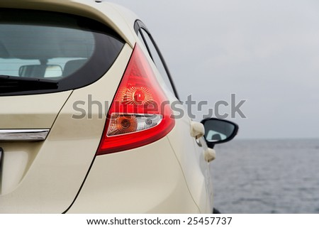 Rear light of a modern hatchback detail - stock photo