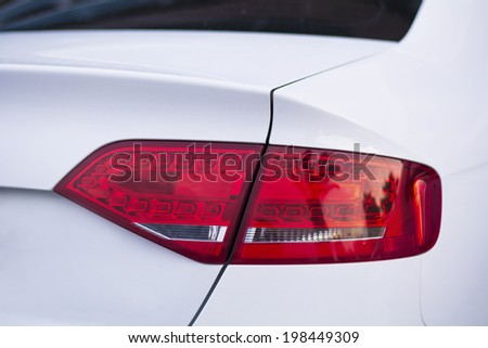 Rear light of a modern white car - stock photo