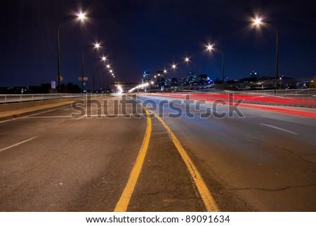 Rear light of cars on a bridge illuminated in Montreal. ( Night Scene ) - stock photo