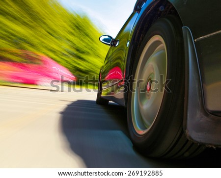 Rear side view of turning vehicle.  - stock photo