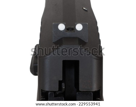 Rear sight on a handgun that has a pair of white dots