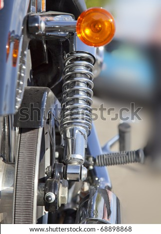 Rear suspension of a chopper motorbike - stock photo