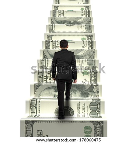 rear view businessman walking on money stairs isolated in white background - stock photo