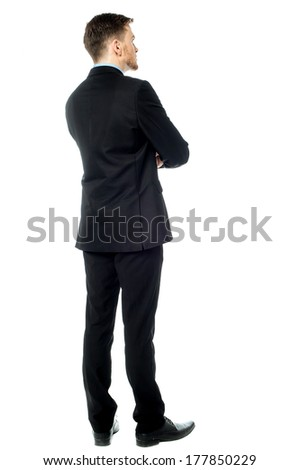 Rear view image of young male business executive - stock photo