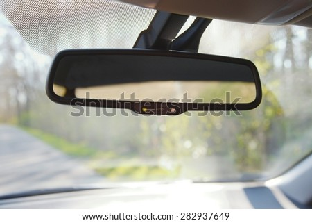 Rear view mirror of a car - stock photo