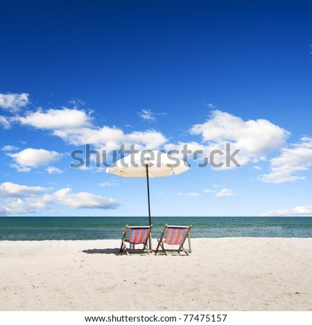 Rear view of a beach chair on the beach - stock photo