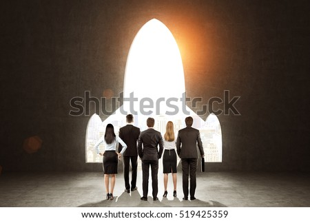 Rear view of a business team standing near black wall with a plane shaped opening in it. Concept of project launching. Toned image
