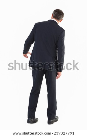 Rear view of a businessman gesturing on white background