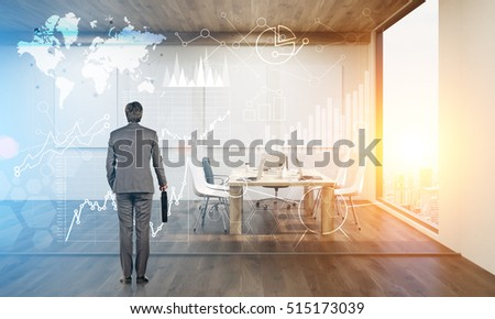 Rear view of a businessman looking at holographic world map and diagrams on a glass conference room wall. 3d rendering. Mock up. Toned image. Double exposure. Elements of this image furnished by NASA