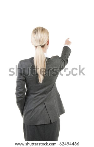 Rear view of a businesswoman pointing at copy-space
