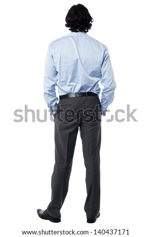 Rear view of a casual businessman, full length shot - stock photo
