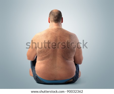 Rear view of a fat man - stock photo