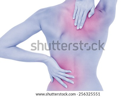 Rear view of a fit topless young woman with back pain standing over white background - stock photo