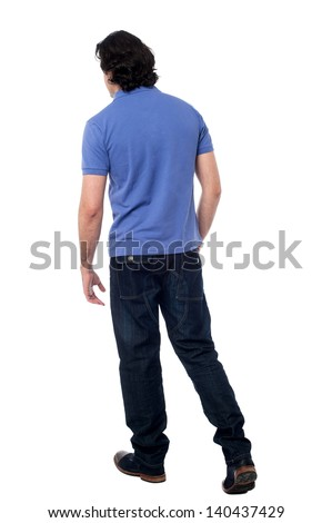 Rear view of a handsome man against white background - stock photo